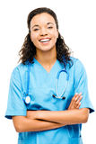 Happy mixed race nurse smiling arms folded isolated on white  Stock Photo