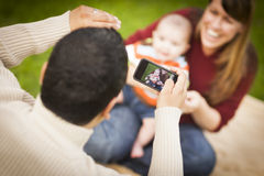 Happy Mixed Race Parents and Baby Boy Taking Self Portraits Stock Photography