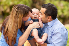 Happy Mixed Race Parents Playing with Their Son Stock Photos
