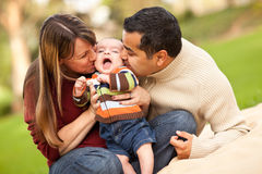 Happy Mixed Race Parents Playing with Their Son. Happy Mixed Race Parents Playing with Their Giggling Son Royalty Free Stock Images