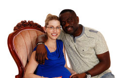 Happy mixed race pregnant couple. Stock Photos