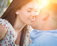Happy Mixed Race Romantic Couple Kissing Outdoors Stock Images