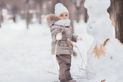Happy Mixed Race Toddler Girl on the snow day Royalty Free Stock Image