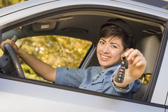 Happy Mixed Race Woman in Car Holding Keys stock photography