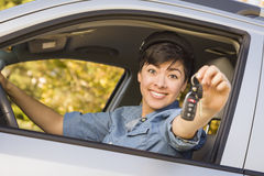 Happy Mixed Race Woman in Car Holding Keys Stock Images
