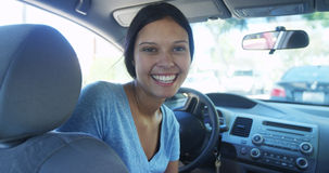 Happy mixed race woman sitting in car smiling Stock Photos