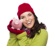 Happy Mixed Race Woman Wearing Winter Hat Holding Piggybank Royalty Free Stock Photos