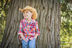Happy Mixed Race Young Boy Wearing Cowboy Hat Standing Outdoors. Mixed Race Young Boy Wearing Cowboy Hat Standing Outdoors stock images