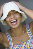 Happy mixed race young woman in hat, close-up Royalty Free Stock Photos