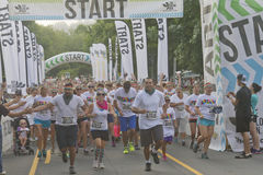 Happy Mob of Color Runners Start the Race Stock Photo