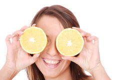 Happy model eating an orange Stock Photo