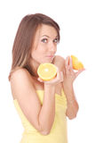 Happy model eating an orange Royalty Free Stock Photos