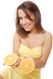 Happy model eating an orange Stock Image