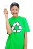 Happy model wearing recycling tshirt holding light bulb Royalty Free Stock Photography