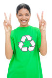 Happy model wearing recycling tshirt making peaceful gesture Stock Image
