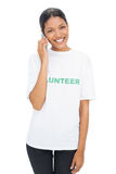 Happy model wearing volunteer tshirt having a phone call Royalty Free Stock Photography