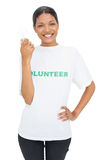 Happy model wearing volunteer tshirt holding light bulb Stock Photos