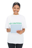Happy model wearing volunteer tshirt holding tablet Stock Image