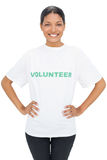 Happy model wearing volunteer tshirt posing Stock Images