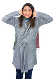 Happy model with winter clothes making phone call gesture Royalty Free Stock Photos