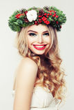 Happy Model Woman with Christmas Wreath. Beautiful Woman Stock Photos