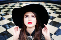 Happy Model Woman in a Hat Look Up Outdoors Stock Photo