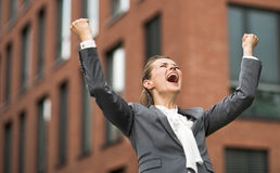 Happy modern business woman against office building rejoicing. The new business. Happy modern business woman against office building rejoicing Stock Photography