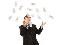 Happy modern businessman catching money isolated Stock Image