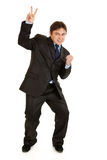 Happy modern businessman showing victory gesture Royalty Free Stock Photo