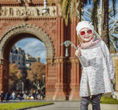 Happy modern child in Barcelona, Spain showing thumbs up Royalty Free Stock Photo
