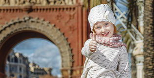 Happy modern child in Barcelona, Spain showing thumbs up Royalty Free Stock Image