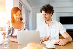 Happy modern couple working on laptop at home Royalty Free Stock Images