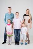 Happy modern family of five people. In the studio royalty free stock photo
