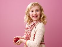 Happy modern girl isolated on pink background with raspberries Stock Photography