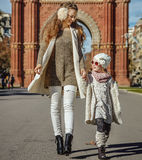 Happy modern mother and child in Barcelona, Spain walking Stock Photography
