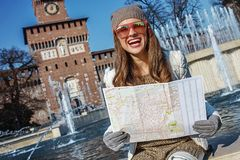 Happy modern woman in Milan, Italy having excursion. Rediscovering things everybody love in Milan. happy modern woman in Milan, Italy having excursion Royalty Free Stock Photography