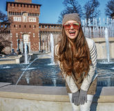 Happy modern woman near Sforza Castle in Milan, Italy Royalty Free Stock Image