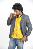 Happy modern young man drinking black tea Royalty Free Stock Images