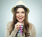 Happy modern young smiling woman portrait with smoothie juice. Royalty Free Stock Image