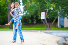 Happy mom and adorable little girl enjoying summer Stock Image