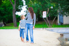 Happy mom and adorable little girl enjoying a walk Royalty Free Stock Photo