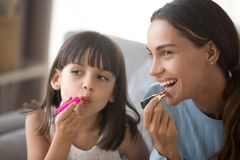 Free Happy Mom And Kid Daughter Having Fun Doing Makeup Together Stock Photography - 136881452