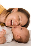 Happy mom and baby. Happy mom stands and holds the baby stock photo