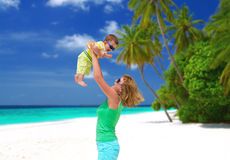 Happy mom with baby on the beach Stock Photo