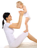 Happy mom and baby. Doing exercise Royalty Free Stock Image