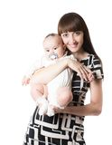 Happy mom and baby girl hugging Stock Photography