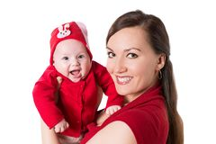 Happy mom and baby girl hugging and laughing. Stock Photography