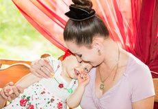 Happy mom and baby girl hugging and laughing. The concept of childhood and family. Royalty Free Stock Photo