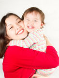 Happy mom and baby girl laughing Stock Photos