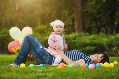 Happy mom and baby in the green park Royalty Free Stock Photo